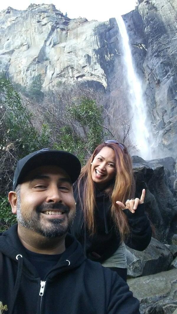 The foster family, the Casas, in front of a beautiful waterfall.